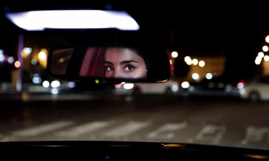 Hessah al-Ajaji drives her car down the capital's busy Tahlia Street after midnight for the first time, in Riyadh, Saudi Arabia.