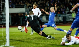 Michael Lang sidefoots what proves to be the winner for Switzerland against Iceland.