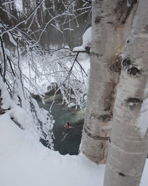 A woman enjoying a winter soak in the Liard River Hot Springs.