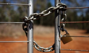 A lock and chain secures an access gate to a property owned by coal-seam gas miner Santos during a blockade of the property by local landholders north of Sydney in 2011. The panel recommended looking into ways to create a 'more harmonious interaction and exploitation of resources'.