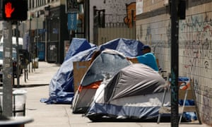 The homelessness crisis is evident along the sidewalks and streets in the skid row area of downtown Los Angeles.