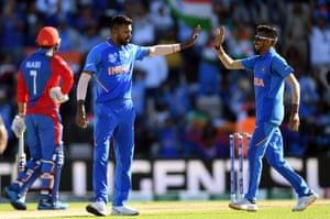 Hardik Pandya (left) and Yuzvendra Chahal of India celebrate the wicket of Najibullah Zadran of Afghanistan.