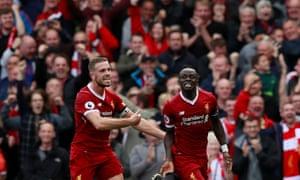 Sadio Mané celebrates scoring against Crystal Palace with Jordan Henderson.