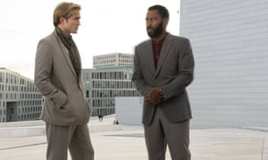 """This image released by Warner Bros. Entertainment shows Robert Pattinson, left, and John David Washington in a scene from """"Tenet."""" Warner Bros. says it is delaying the release of Christopher Nolan's sci-fi thriller """"Tenet"""" until Aug. 12. (Melinda Sue Gordon/Warner Bros. Entertainment via AP)"""