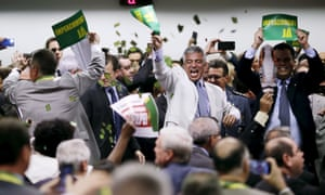 Members of the impeachment committee celebrate after voting on the impeachment of Brazilian President Dilma Rousseff Monday in Brasilia.