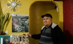 Calogero Petralia, 68, shows a picture of Poggioreale after the earthquake, which struck when he was 18. He now lives in Poggioreale Nuova.