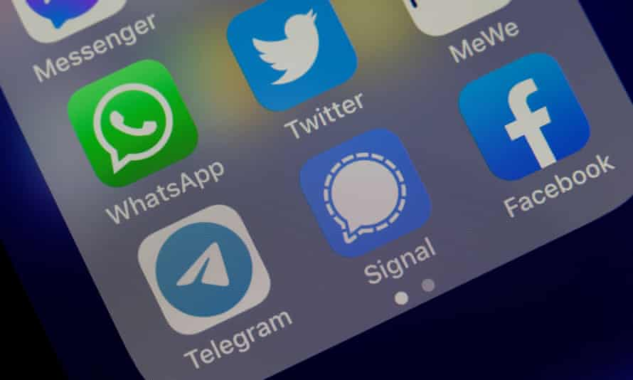 A smartphone showing the logos for WhatsApp, Facebook, Twitter, Telegram and Signal