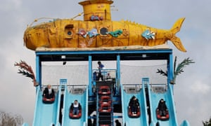 Members of the public ride on the Depth Charge water slide ride at Thorpe Park theme park in Chertsey, southwest of London as coronavirus restrictions are eased after England's third national lockdown.