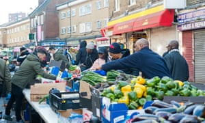 East Street Market, Walworth, south London: shopping continues despite the lockdown.