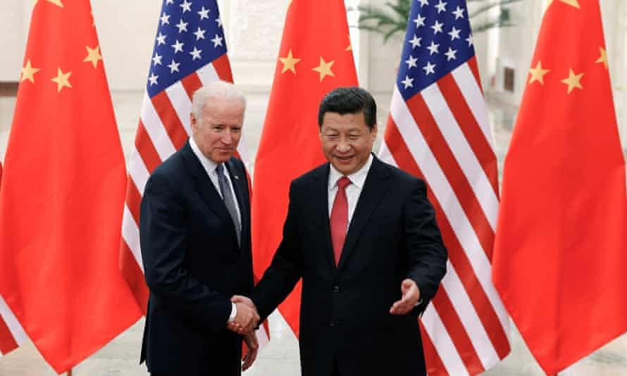 Joe Biden, as US vice-president, meets Xi Jinping inside the Great Hall of the People in Beijing in 2013.