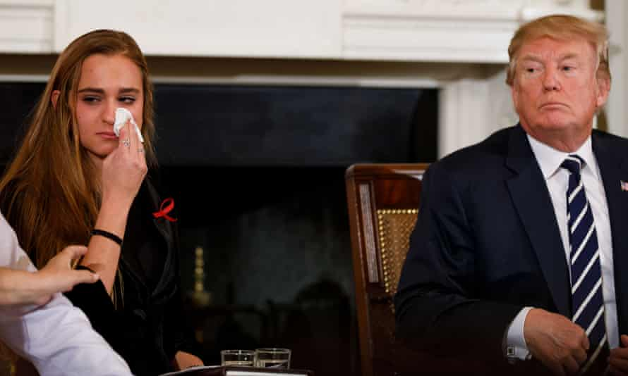 Julia Cordover, the student body president at Marjory Stoneman Douglas High School wipes away tears during a listening session hosted by Donald Trump at the White House