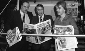 Brian MacArthur, centre, with Eddy Shah, left, and printer Kevin Clarke with copies of Today newspaper, which was launched in 1986. MacArthur was its founding editor.