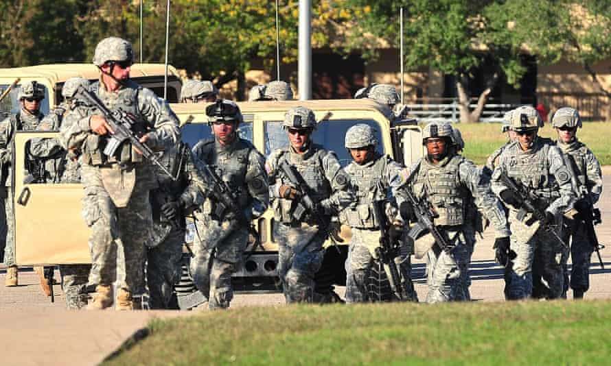 Soldiers storm the grounds of Fort Hood to help apprehend Nidal Malik Hasan, following a mass shooting on 5 November 2009