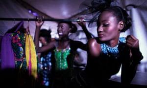 Models wait backstage during Dakar fashion week.