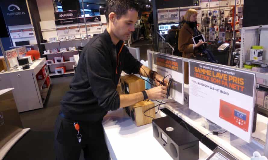 A worker arranges digital radios in an electronics shop in Oslo