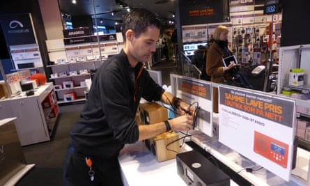 A worker displays digital radios at an electronics outlet in Oslo