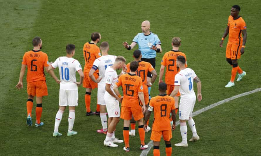 Sergei Karasev deals with a heated situation during the match between the Netherlands and the Czech Republic.
