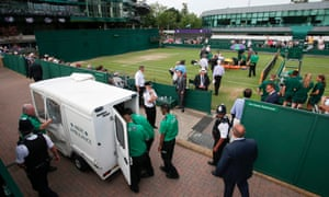 Bethanie Mattek-Sands is helped by medics on the court as an ambulance is readied to take her for treatment after suffering an injury during her second round match against Romania's Sorana Cirstea.