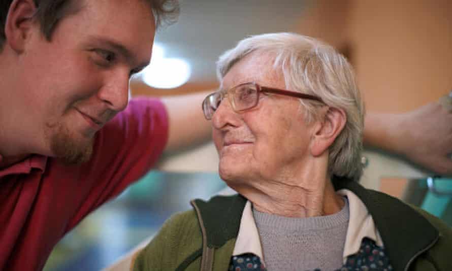 Male nurse speaking to elderly woman