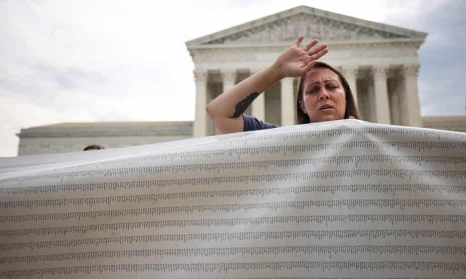 An anti-abortion activist holds a petition to end abortion during a demonstration outside of the supreme court on Monday.