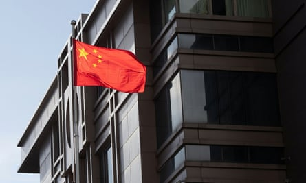China's national flag is seen waving at the China Consulate General in Houston, Texas, U.S