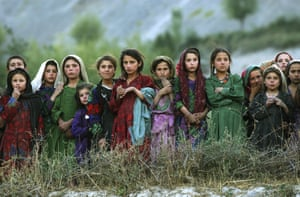 Badakhshan province, 2004. Local girls in the remote village of Ghumaipayan Mahnow watch UN workers delivering ballot papers.