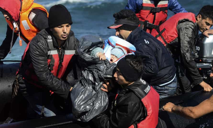Migrants arrive by raft on the Greek island of Chios