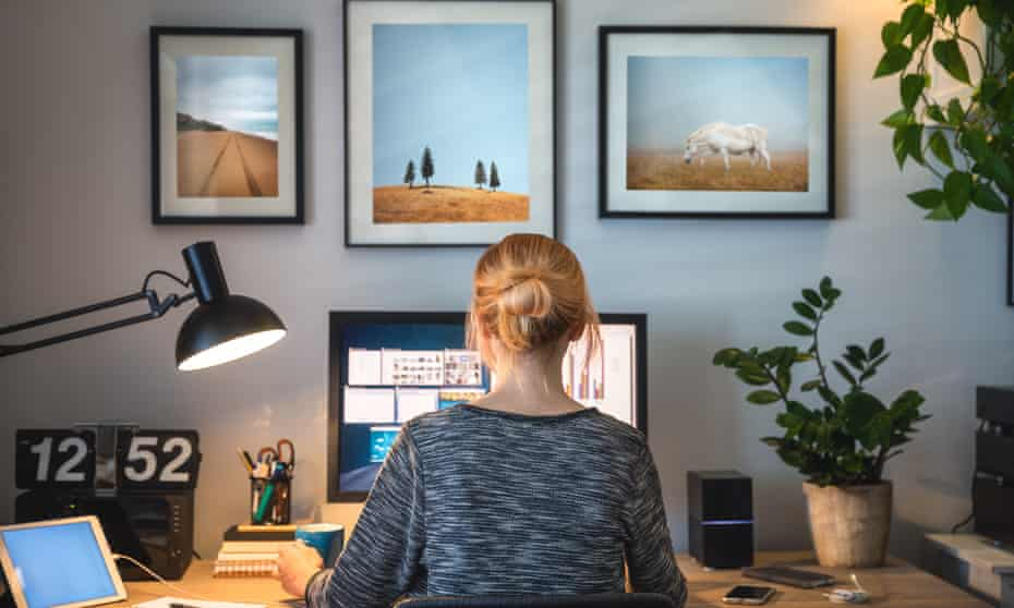 Woman working on computer in her home office during pandemic quarantine.