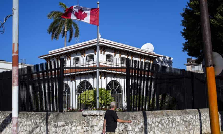 A man walks beside Canada's embassy in Havana, Cuba