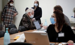 People wait to receive the AstraZeneca Covid-19 vaccine at the Clinique de l'Estree - ELSAN private hospital in Stains as part of the vaccination campaign in France, March 5, 2021.