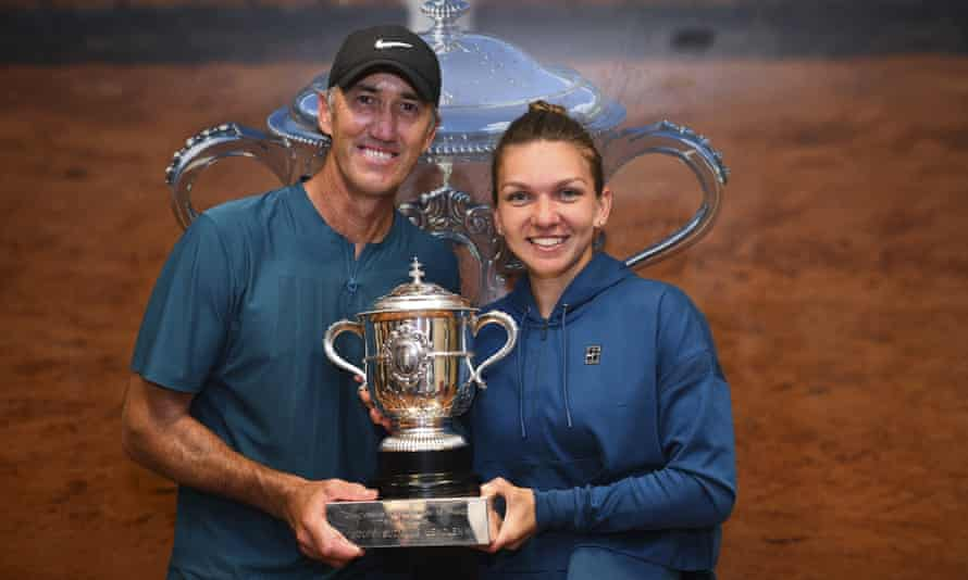 Simona Halep poses with her coach Darren Cahill and the French Open trophy