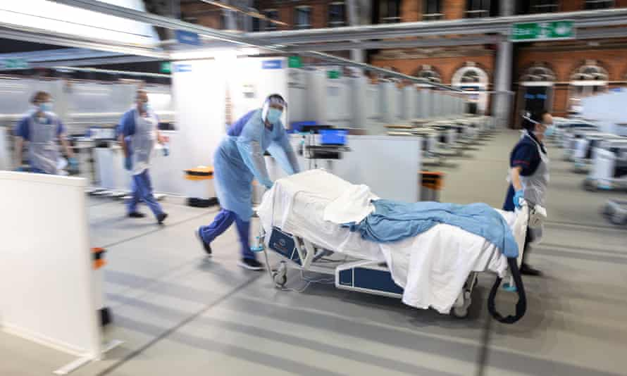 Staff at the new NHS Nightingale field hospital in Manchester preparing to treat Covid-19 patients.