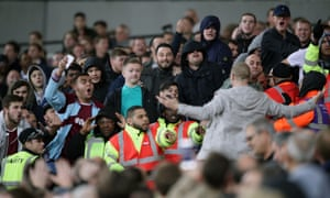 Words are exchanged between West Ham and Chelsea fans.
