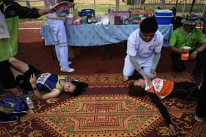 Women lying down from exhaustion after competing in the 400-metre race