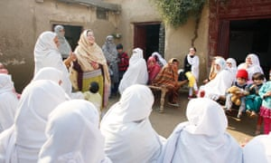 Saba Ismail, co-founder of Aware Girls with sister Gulalai, addresses women at a community event in Mardan.
