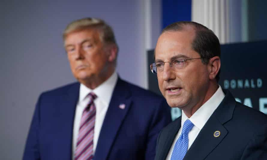Alex Azar with Trump in November. Azar said the distribution plan was being run by the military and private sector.