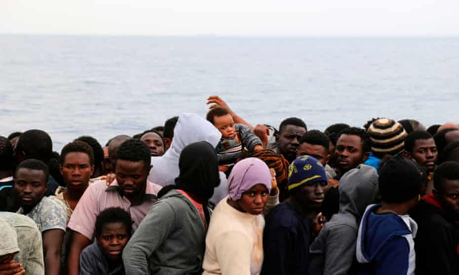 Migrants wait to be rescued from a sinking dingy off the Libyan coastal town of Zawiyah.
