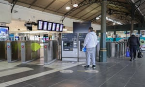 Man stands at train station