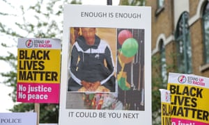 Campaigners hold a vigil outside Stoke Newington police station in London after the death of Rashan Charles