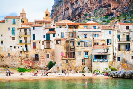 People at beach Cefalu old town Sicily Cefalu, Italy