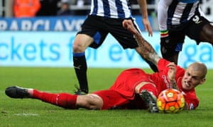 Liverpool's Martin Skrtel falling victim to a deflected own goal