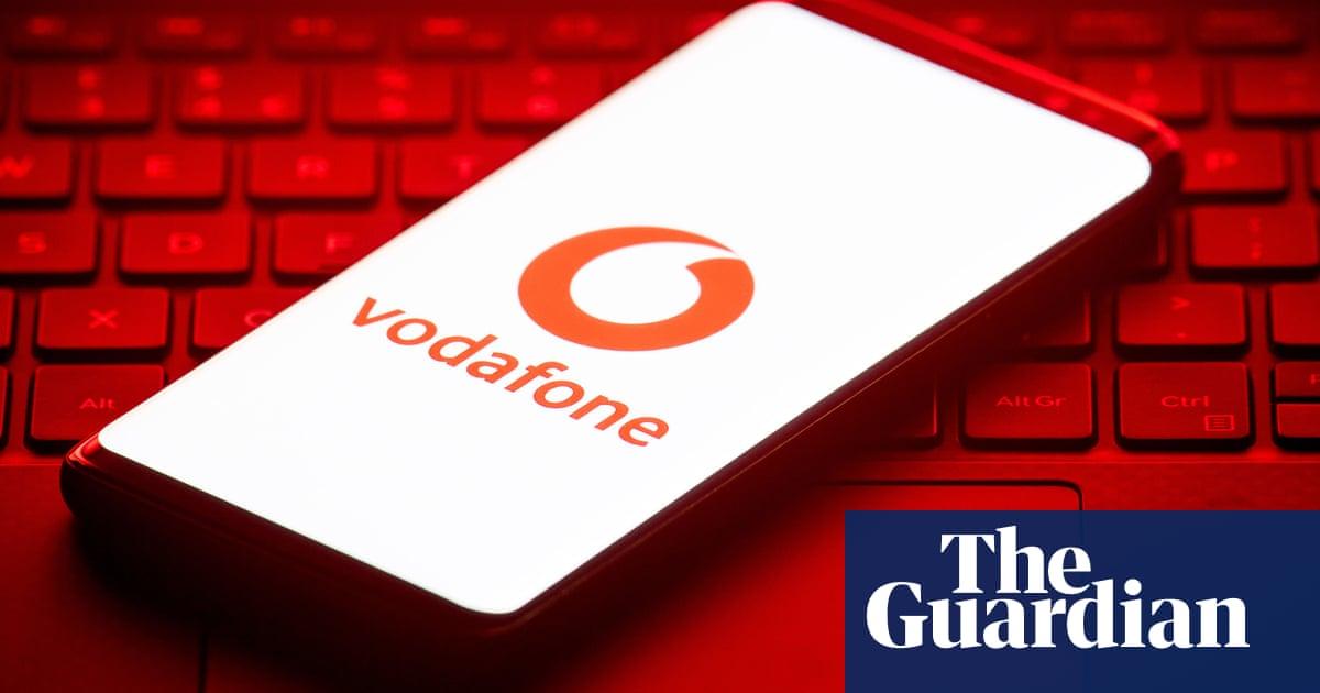 Vodafone shares sink after revenues slump
