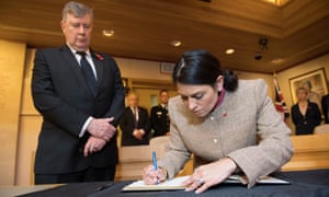 Home secretary Priti Patel signs a book of condolence for the 39 people who died in a lorry container in Essex.
