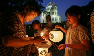A Hiroshima resident prepares for a lantern procession to comfort the souls of victims killed by the atomic bombing 70 years ago on 6 August