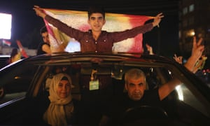 Supporters of the pro-Kurdish Peoples' Democratic Party (HDP) celebrate in Diyarbakir, southeastern Turkey, late Sunday.