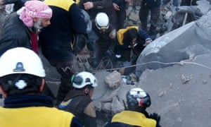 Rescuers search through rubble left by an airstrike in Syria's Idlib province this month.
