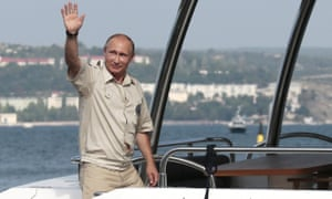 Job done: Putin waves after emerging from the Russian Geographical Society's craft