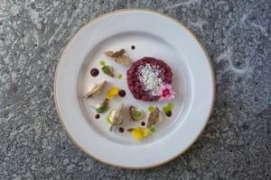 Not your average steakhouse: ash-baked beetroot with goat's curd, elderberry vinegar and pecans.