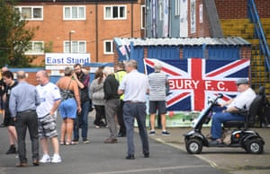 Bury supporters await for news outside the ground.