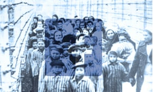 Survivors of Auschwitz behind a barbed wire fence in February 1945